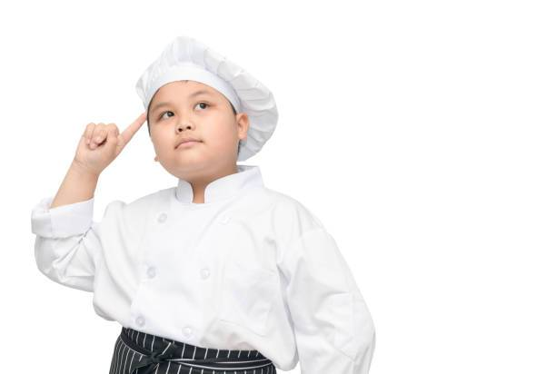 kid chef is thinking new menu. asian boy chef thinking isolated on white background with clipping path